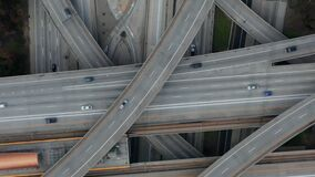 AERIAL: Slow Overhead Flighty Shot of Judge Pregerson Highway showing multiple Roads, Bridges, Viaducts with little car