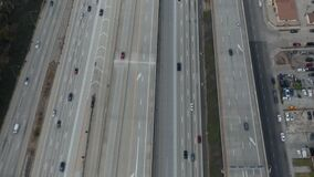 AERIAL: Slow Overhead Lookup over 110 Highway with little car traffic in Los Angeles, California on Cloudy Overcast Day