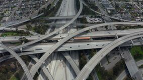 Slowly Circling Aerial View over Judge Pregerson Interchange Highway showing multiple Roads with little car traffic in