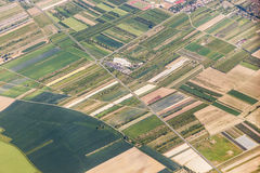 Aerial of small village with fields Royalty Free Stock Photos