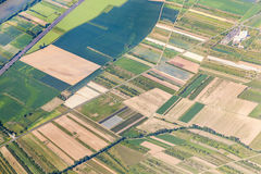 Aerial of small village with fields Stock Photo