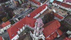 AERIAL. Smooth flight around beautiful abandoned Blessed Virgin Mary of Consolation church in Vilnius old town, Lithuania stock video
