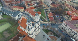 AERIAL. Smooth 360 flight around beautiful Church of St. Catherine (Kotrynos) in Vilnius old town, Lithuania. Panorama of Vilnius stock footage