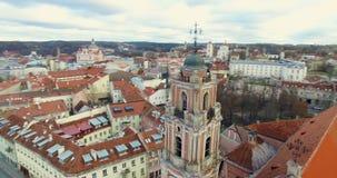 AERIAL. Smooth 360 orbit flight around beautiful Church of All Saints (Visu Sventuju) in Vilnius old town, Lithuania. Panorama of stock video