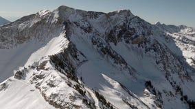 Aerial of Snow on Mountain Ridge Line stock video footage