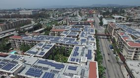 Aerial solar power video. Solar power rooftops aerial video