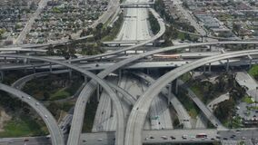 Aerial: spectacular Judge Pregerson Highway showing multiple Roads, Bridges, Viaducts with little car traffic in Los