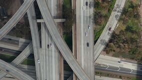 Aerial: spectacular overhead follow shot of Judge Pregerson Highway showing multiple Roads, Bridges, Viaducts with