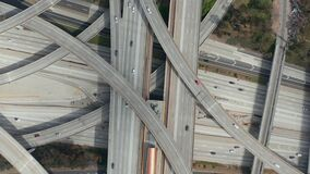 Aerial: spectacular overhead shot of Judge Pregerson Highway showing multiple Roads, Bridges, Viaducts with little car