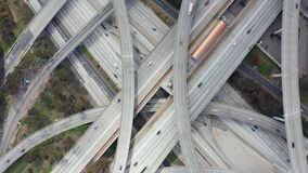 AERIAL: Spectacular Overhead Shot Rising up over Judge Pregerson Highway showing multiple Roads, Bridges, Viaducts with