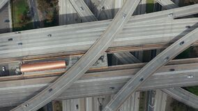 Aerial: spectacular turning overhead shot of judge Pregerson highway showing multiple roads, bridges, viaducts with