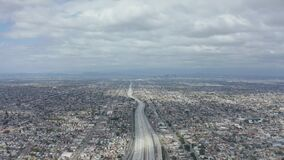 AERIAL: Spectacular View over Endless City Los Angeles, California with Big Highway Connecting to Downtown on Cloudy