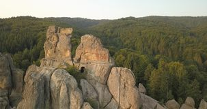 Tustan fortress - archaeological and natural monument of national significance, popular tourist landmark. Urych, Carpathian Mounta. Aerial spectacular view to stock video footage