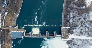 Aerial. Spring flood water flowing on hydroelectric power station. Dam. stock video footage