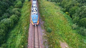 An aerial of a steam orange train stock footage