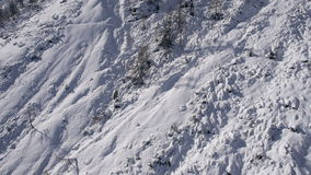AERIAL: Steep mountain terrain covered with snow stock video