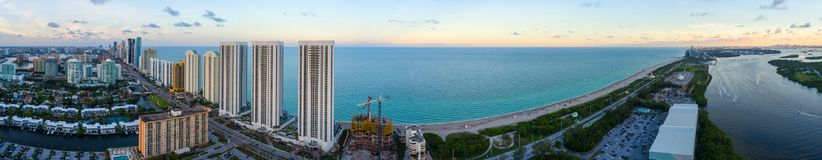 AErial dusk panorama Sunny Isles Beach and Haulover Park. Aerial stotched image of Sunny Isles Beach FL and Haulover Park Biscayne Bay Royalty Free Stock Image