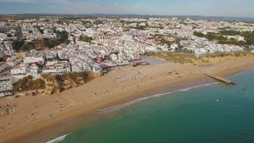 Aerial. Summer beach fishermen view from sky, in Albufeira. stock footage