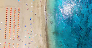 AERIAL. Summer beach with people and turquoise ocean water Royalty Free Stock Image