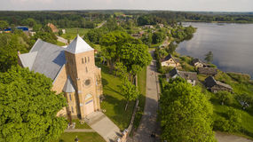 AERIAL. Summer shot of Vepriai church and lake Stock Photography