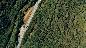 Aerial summer view with the forest, highway, cars, trucks in a mountains stock footage