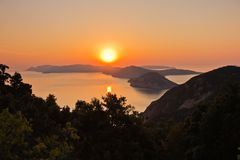 Aerial sunrise behind Alonisos island from the top of a hill in Skopelos royalty free stock photography