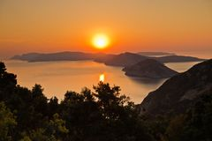 Aerial sunrise behind Alonisos island from the top of a hill in Skopelos. Greece stock photo