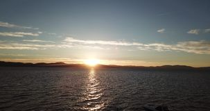 Aerial of the sunset from the drone flying over Lake Tahoe. Nevada.USA stock video footage