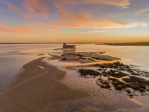 Aerial sunset panoramic and historic life-guard building at Fuseta, Algarve. Aerial sunset and historic life-guard building at Fuseta fishing town, in Ria Royalty Free Stock Photography