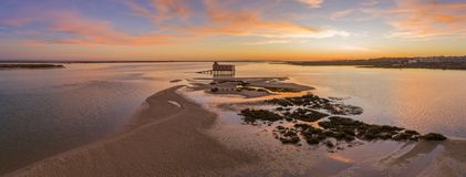 Aerial sunset panoramic and historic life-guard building at Fuseta, Algarve. Aerial sunset panoramic and historic life-guard building at Fuseta fishing town, in Stock Photos