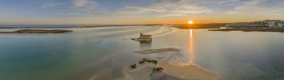 Aerial sunset panoramic and historic life-guard building at Fuseta, Algarve. Aerial sunset panoramic and historic life-guard building at Fuseta fishing town, in Royalty Free Stock Image