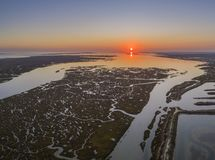 Aerial sunset seascape in Ria Formosa wetlands natural park, inland maritime channel. Algarve. Portugal Stock Photos