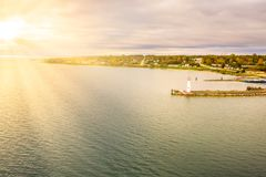 Aerial sunset view of wawatam lighthouse at the harbor of St. Ignace, Michigan in the Straits of Mackinac stock photos