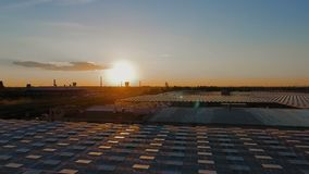 Aerial sunset view agricultural greenhouses stock video footage