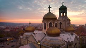 Aerial sunset view of The Cathedral of the Assumption in Varna, Bulgaria. Aerial sunset view of The Cathedral of the Assumption in Varna city, Bulgaria stock video footage