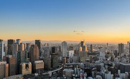 Aerial sunset view of cityscape business downtown in Osaka, Japan. Osaka commercial and business cityscape at sunset from Umeda Sky Building in Osaka, Japan Stock Image