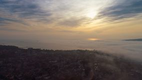 Aerial sunset view over The Cathedral of the Assumption in Varna, Bulgaria and street traffic in the city center.  stock footage