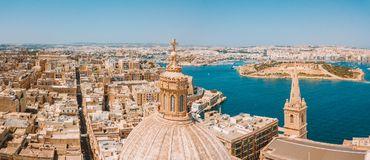 Aerial sunset view over Our Lady of Mount Carmel basilica. A domed cathedral that overlooks the ancient capital city of Valletta, Malta. Island country in the Stock Photography