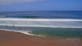 Aerial from surfing at Arifana in Portugal stock footage