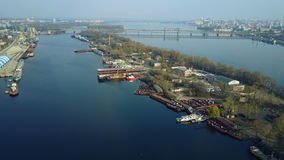 Aerial survey of cargo port. Aerial survey of a cargo port on the Dnieper River. 4K stock footage