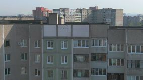 Aerial survey. Cityscape, old architecture. Houses of the times of the USSR. The city from the height of a bird`s flight at sunny day. Old houses in a big stock footage