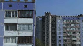 Aerial survey. Cityscape, old architecture. Houses of the times of the USSR. The city from the height of a bird`s flight at sunny day. Old houses in a big stock video footage
