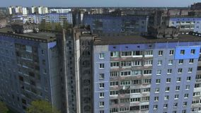 Aerial survey. Cityscape, old architecture. Houses of the times of the USSR. The city from the height of a bird`s flight at sunny day. Old houses in a big stock video