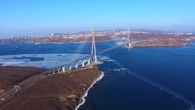 Aerial survey of marine landscape with views of the Russian bridge. Vladivostok, Russia stock footage