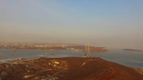 Aerial survey of marine landscape with views of the Russian bridge. Vladivostok, Russia stock video