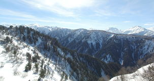 Aerial survey of mountains in winter in 4k stock footage