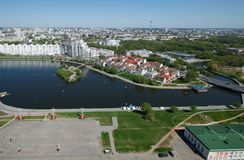 Aerial surveys with helicopter photographed island and a monument. Minsk. Panoramic view of the Trinity Suburb and the general appearance of the city Royalty Free Stock Images