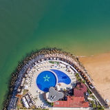 Aerial. Swimming pool on the ocean. The photo from sky is shot by drones. Stock Image