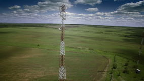 Aerial telecommunication antenna communication cellular cellphone relay tower. Medium shot. stock video