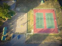 Aerial tennis court at public park in Ozark, Arkansas, USA. Aerial view tennis court at public park in Ozark, Arkansas, America at sunset. Top view outdoor court royalty free stock image